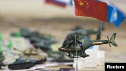 Miniatures depicting troops of different nations sit on a plan for SCO military exercises in 2010.