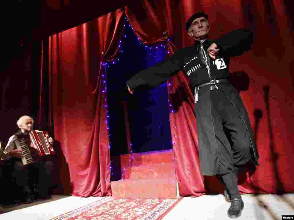 Vladimer Zangurashvili, 70, shows off a traditional dance.