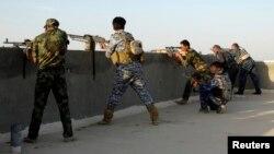 Ирак қауіпсіздік күштері содырлармен атысып жатыр. Рамади, 26 мамыр 2014 жыл