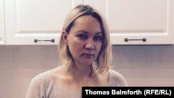 Рубль арзандаған сайын доллармен алған ипотекалық несиесін төлеуі қиындаған Мәскеу тұрғыны Елена Балановская.