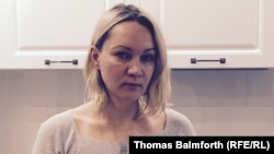 Yelena Balanovskaya stands in the newly decorated kitchen of the apartment that she bought with a dollar mortgage that she's now struggling to pay off because of the ruble crisis.