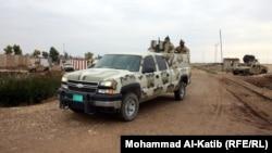 جنود عراقيون في دورية بناحية ربيعة قرب الحدود مع سوريا