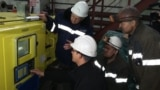 """Miners and foreign specialists inspect new equipment at the mine """"Kazakhstan"""". Karaganda region, October 26, 2017."""