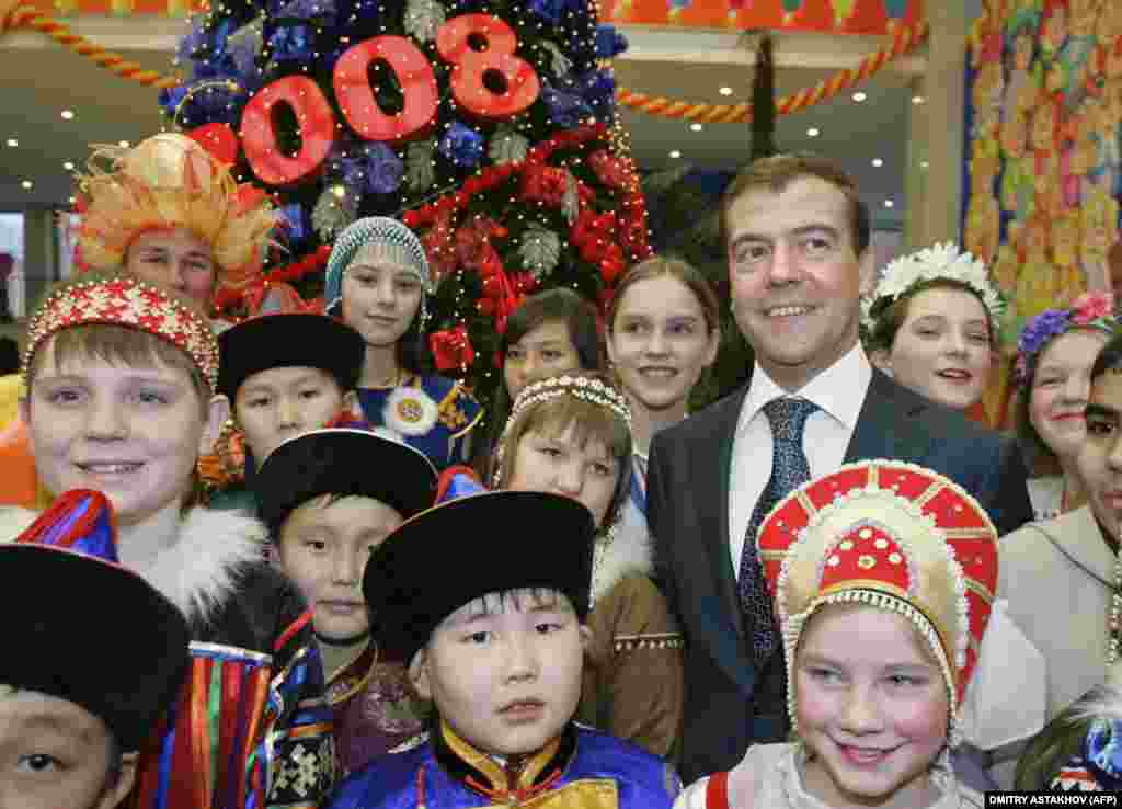 In 2005, Putin appointed Medvedev first deputy prime minister, giving him the power to implement large domestic projects. In this 2007 photo, Medvedev smiles at the All-Russian New Year's Party at the Kremlin.