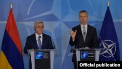 Belgium - NATO Secretary General Jens Stoltenberg and Armenian President Serzh Sarkisian meet the press after talks in Brussels, 27Feb2017.