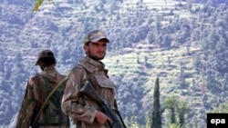 Pakistani Army soldiers stand guard in the Swat Valley.