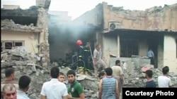 آثار انفجار الثلاثاء في قضاء الطوز في 21 آيار 2013