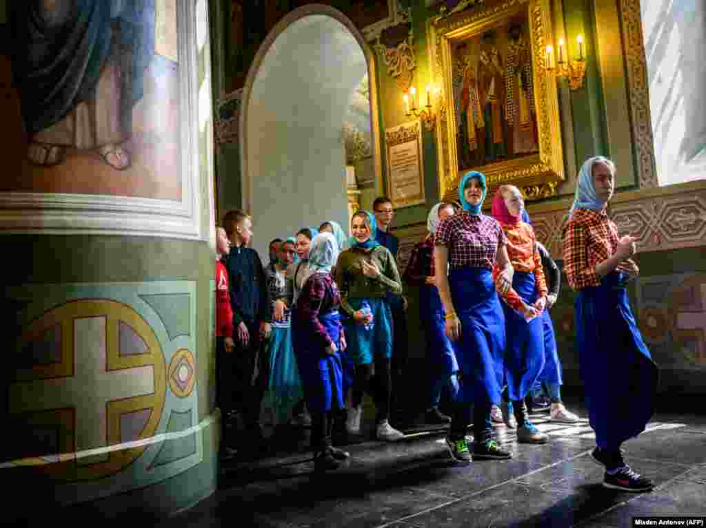 A group of schoolchildren visits a church in the Kremlin in the Russian city of Kazan. (AFP/Mladen Antonov)