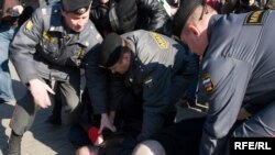 Russian police dealing with a Moscow protest against the falsified regional elections.
