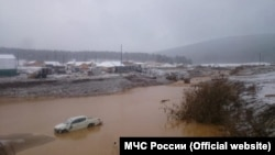 The scene at the dam collapse in Krasnoyarsk Krai.