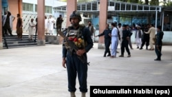Afghan soldiers secure the hospital after injured victims of the suicide bomb attack at an election campaign in Kama district are brought to a hospital in Jalalabad on October 2.