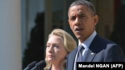 Хиллари Клинтон и Барак Обмама. Вашингтон, 2012 год.