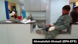 Afghan police officers who were injured in the attack receive medical treatment at a hospital in Paktia.