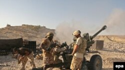 British troops in Afghanistan fire at Taliban positions in September.