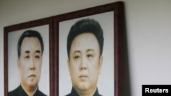 Portraits of North Korea's founder and former leader Kim Il Sung (left) and his son and current leader Kim Jong Il. No confirmed photos exist of Kim Jong Il's presumed successor, his son Kim Jong Un.