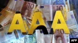 Moody's has warned that it may cut the triple-A ratings of France, the United Kingdom and Austria. -