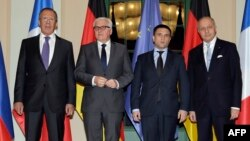 Ресей, Германия, Украина және Франция сыртқы істер министрлері (солдан оңға қарай): Сергей Лавров, Франк-Вальтер Штайнмайер, Павел Климкин және Лоран Фабиус. Берлин, 21 қаңтар 2015 жыл.