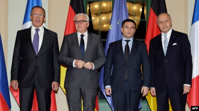 Russian Foreign Minister Sergei Lavrov, German Foreign Minister Frank-Walter Steinmeier, Ukrainian Foreign Minister Pavlo Klimkin and France's Foreign Minister Laurent Fabius ahead of their meeting in Berlin.