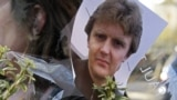 A picture of former Russian security agent Aleksandr Litvinenko is pinned to flowers outside University College Hospital in central London on November 23, 2007.<br /> <br /> Litvinenko, 43, fell ill on November 1, 2006, after he drank tea that was poisoned with polonium-210, a rare, highly radioactive isotope. He died several days later in the hospital.