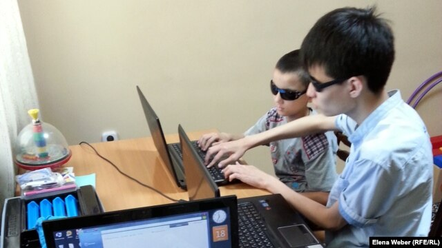 Adil Uralbaev (right), who was born without sight, says the Internet changed everything for him.