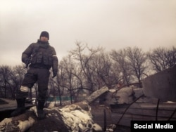 Бато Домбаев на танке, около украинского города Углегорск (Донецкая область)