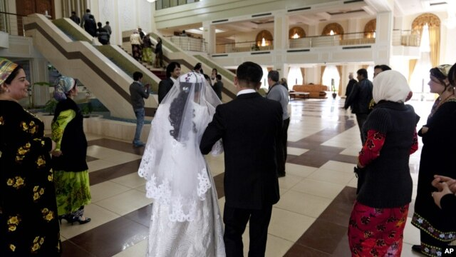 Newlyweds arrive at a civil marriage-registration office in Dushanbe.