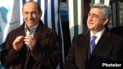 Amenia -- President Serzh Sarkisian (R) and his predecessor Robert Kocharian attend an official ceremony.