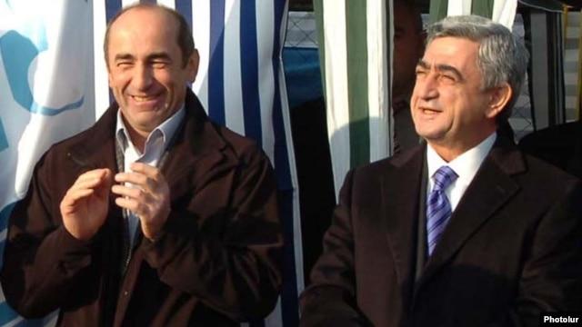 Amenia -- Armenian President Serzh Sarkisian (R) and his predecessor Robert Kocharian.