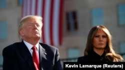 U.S. President Donald Trump and first lady Melania Trump participate in a 9/11 commemoration in Arlington, Virginia.