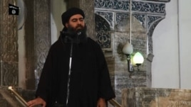 The man purported to be Abu Bakr al-Baghdadi appears in the video