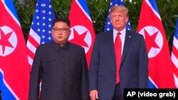 Kim Jong Un, lider Sjeverne Koreje i Donald Trump, predsjednik SAD-a u Singapuru