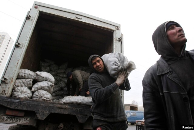 With a huge fall in the ruble, the money millions of migrant workers in Russia send home is worth a lot less than it used to. (file photo)