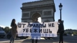 Kazakhstan - France – Students from Kazakhstan supporting activists under arrest Asiya Tulesova and Beybarys Tolymbekov hold a rally. Paris, 24Apr2019.