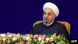 """Our economy will not prosper as long as it is monopolized [by the government],"" said Iranian President Hassan Rohani. (file photo)"