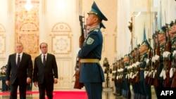 French president Francois Hollande (right) reviews an honor guard alongside his Kazakh counterpart, Nursultan Nazarbaev, in Astana on December 5.