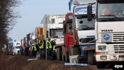 Truck drivers near St. Petersburg take part in protests against a road tax.