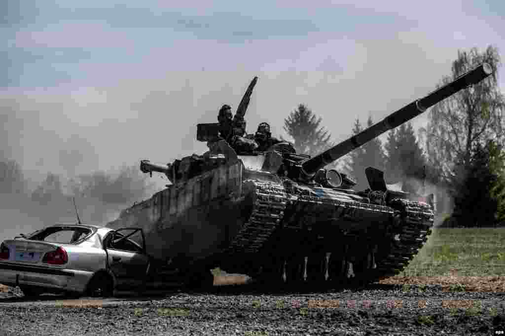 A Ukrainian T-64BM tank goes over a car during the Strong Europe Tank Challenge 2017 at a training ground near Eschenbach in Germany on May 11. (epa/Christian Bruna)