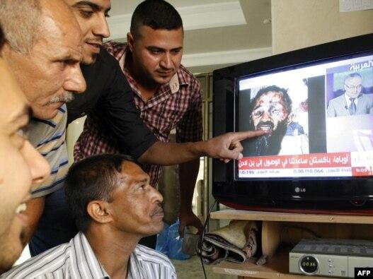پخش گزارش کشته شدن اسامه بن لادن در تلویزیون در بغداد