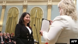 Canada's new Democratic Institutions Minister Afghan-born Maryam Monsef is sworn-in during a ceremony at Rideau Hall in Ottawa on November 4.