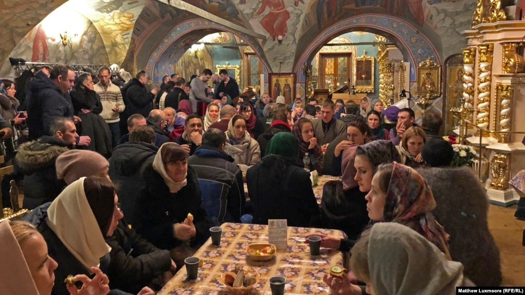 Attendees of the Peter and Fevronia Club mingle at Moscow's Dormition Church.