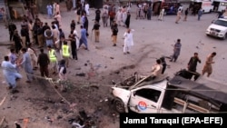 Pakistani security officials inspect the scene of a bomb blast in Quetta on July 30.