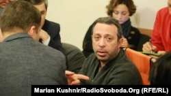 Hennadiy Korban at his trial in Kyiv on December 28. Ukrainian authorities say the influential tycoon and UKROP party leader is suspected of involvement in organized crime.