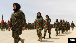 FILE: Afghan female soldiers march in the western city of Herat in April 2014.