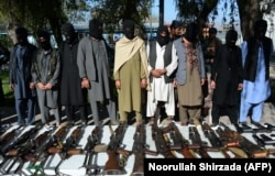 Alleged Taliban fighters and other militants stand handcuffed while being presented to the media at police headquarters in Jalalabad, eastern Afghanistan, earlier this year.