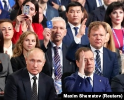 Russian President Vladimir Putin (front left) and Prime Minister Dmitry Medvedev attend a United Russia convention in Moscow in December.