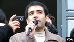 Iranian student activist Majid Tavakoli delivers a speech in an undated photo.