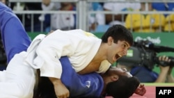 Georgia's Lasha Shavdatuashvili celebrates after defeating Israel's Sagi Muki during their men's -73kg judo contest bronze medal A match of the Rio 2016 Olympic Games in Rio de Janeiro on August 8, 2016.