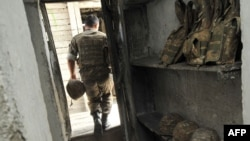 Nagorno-Karabakh -- An Armenian soldier of the self-proclaimed republic of Nagorno-Karabagh leaves a dugout at the frontline on the border with Azerbaijan near the town of Martakert, 06Jul2012
