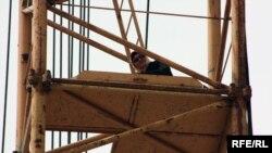 Kulzainat Abilova atop the crane