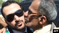 Muntadhar al-Zaidi (left) is welcomed by supporters in Baghdad after his release from prison in September 2009.